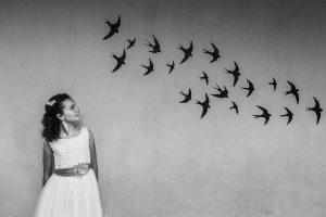Fotos de comunión, comuniones Johnny García, fotógrafo en Extremadura, entre pájaros